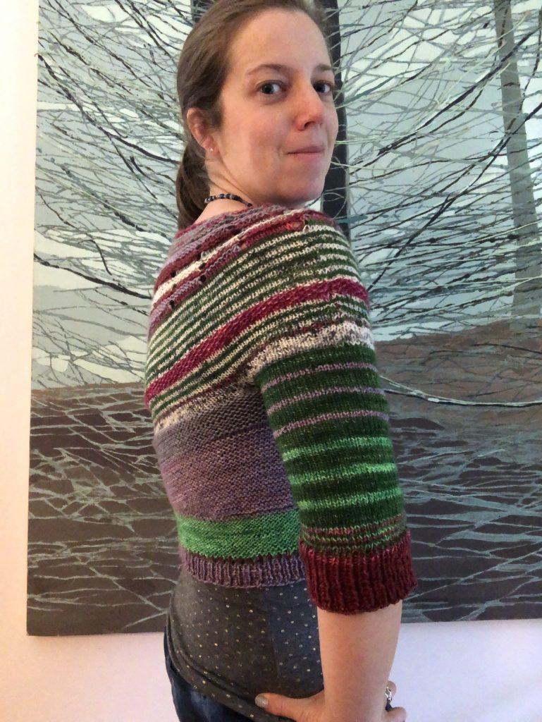 a side view of the stripes of the sweater on the shoulder